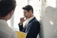 Two businessman at office, thinking - GUSF01054