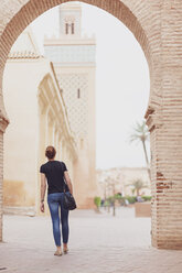 Morocco, Marrakesh, back view of woman looking at Kasbah Mosque - MMAF00486