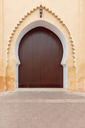 Morocco, Marrakesh, wooden entrance gate at medina - MMAF00489