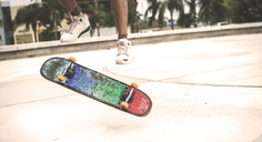 Close up of a skateboard spinning in mid air. - MINF08580