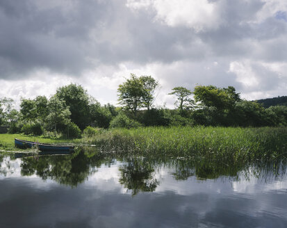 Blue wooden rowboat lying on the shore of Glenade Lake, Glenade, County Leitrim, Ireland. - MINF08677
