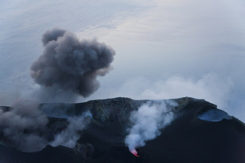 Plumes of smoke and lava emanating from a volcano. - MINF08750