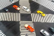 High angle view of cars driving on urban street across pedestrian crossings. - MINF08819