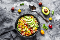 Bowl of bulgur salad with bell pepper, tomatoes, avocado, spring onion and parsley - SARF03916