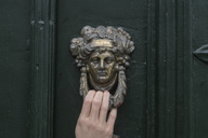 Woman's hand on door knocker, close-up - CHPF00506
