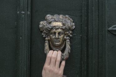 Woman's hand on door knocker, close-up - CHPF00506