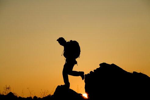 Man hikes in California foothills. - AURF00863
