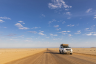 Africa, Namibia, Namib desert, Naukluft National Park, off-road vehicle on gravel road - FOF10071