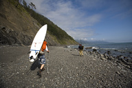 Two men hike with surfboards on The Lost Coast, California. - AURF00942
