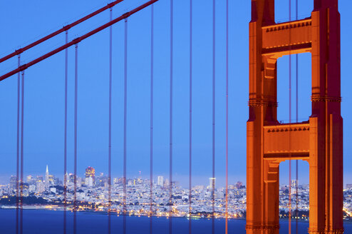 A detail of the Golden Gate Bridge at dusk with San Francisco in the background, California. - AURF01089