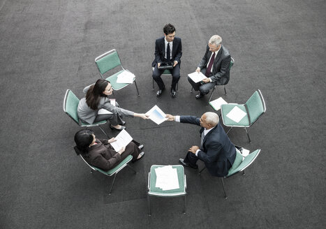 Mixed race group of business people in an informal team building meeting. - MINF08942