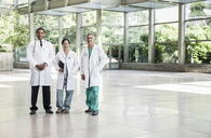 Mixed race group of doctors in lab coats. - MINF08951