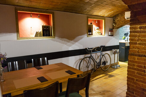 Interior of a restaurant with bicycle inside - AFVF01455