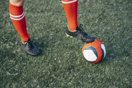 Legs of a woman standing on football ground with the ball - VPIF00512
