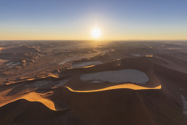 Africa, Namibia, Namib desert, Namib-Naukluft National Park, Aerial view of Deadvlei and 'Big Daddy' against the sun - FOF10128