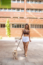 Young woman walking with her dog - ACPF00241