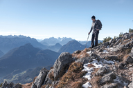 Germany, Bavaria, Berchtesgadener Land, Hochstaufen, hiker looking at view - HAMF00350