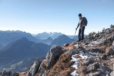 Germany, Bavaria, Berchtesgadener Land, Hochstaufen, hiker looking at view - HAMF00350