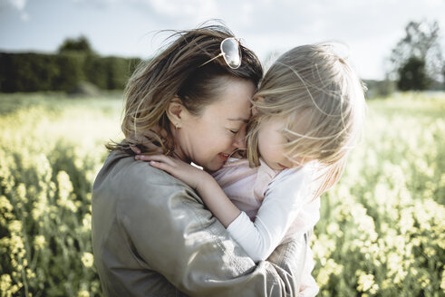 Mother and little daughter together in rape field - PSIF00004