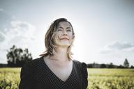 Portrait of woman in rape field - PSIF00022