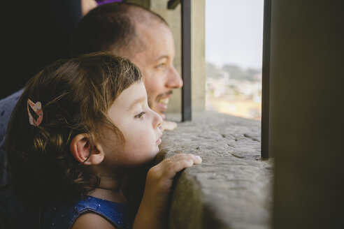 Czechia, Prague, little girl and her father looking at view from the old town hall - GEMF02302