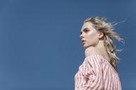Portrait of young woman under blue sky - JESF00116