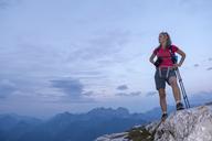 Austria, Salzburg State, Loferer Steinberge, woman on top of mountain enjoying the view - HAMF00361