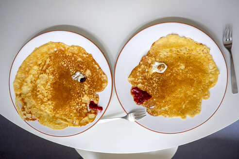 Pancakes, faces on plates, overhead - HAMF00365