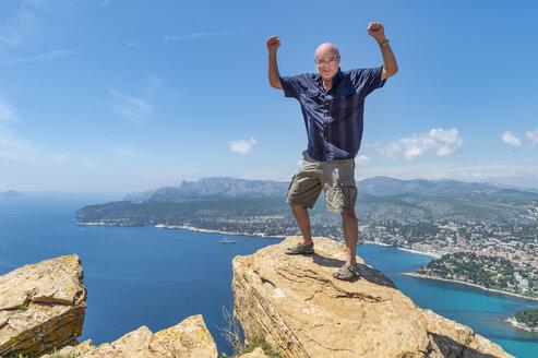 Senior man standing on cliff - FRF00717