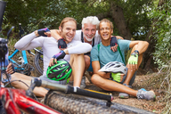 Portrait happy male friends mountain biking, resting - CAIF21372