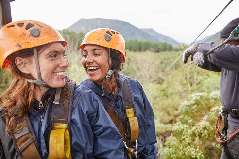 Happy women friends zip lining - CAIF21414