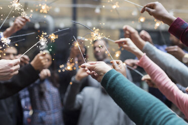 Friends celebrating with sparklers - CAIF21468