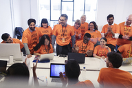 Hackers coding for charity at hackathon - CAIF21489