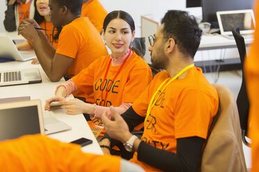 Hackers coding for charity at hackathon - CAIF21504