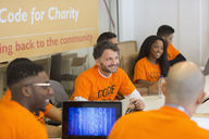 Hackers coding for charity at hackathon - CAIF21525