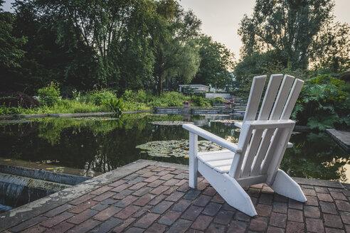 Germany, Hamburg, Planten un Blomen park, empty chair - KEBF00902
