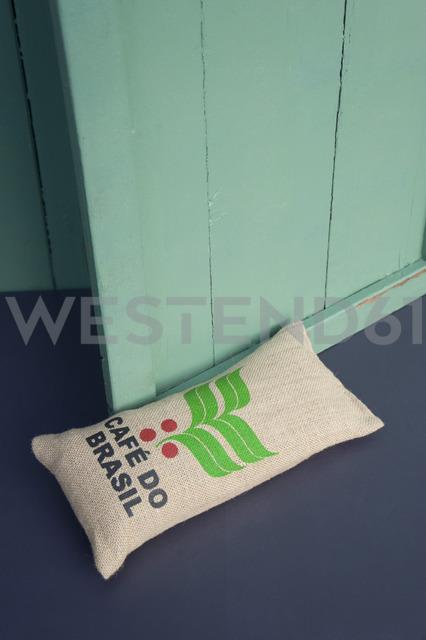Upcycled gunny bag used as door stop - GISF00374