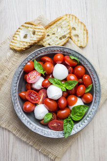 Italian food, caprese, mozzarella and tomatoes and basil - GIOF04245