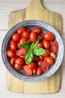 Tomatoes and basil in zinc bowl, overhead view - GIOF04251
