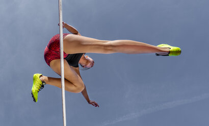 Female hurdler, worm's eye view - STSF01729