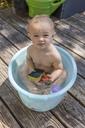 Boy sitting in baby bathtub - TCF05667