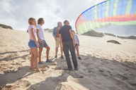 Paragliders with parachute on sunny beach - CAIF21711