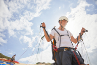 Mature male paraglider preparing equipment - CAIF21723