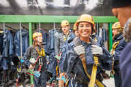 Portrait smiling, eager woman preparing to zip line - CAIF21738