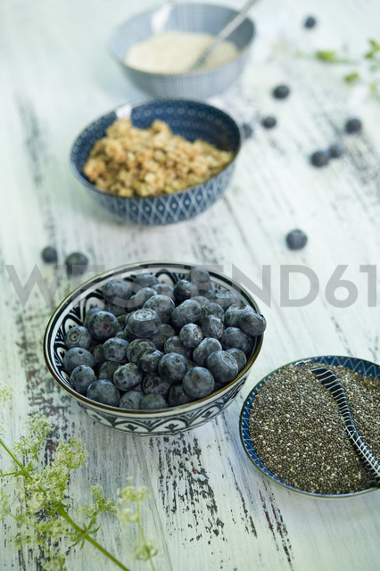 Bowls of blueberries, black chia seeds, granola  and amaranth - ASF06213