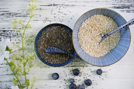 Bowls of black chia seeds and amaranth - ASF06216