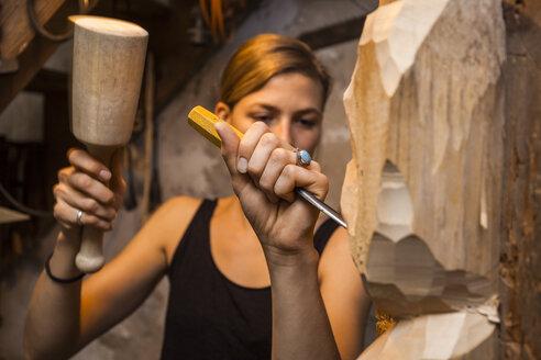 Sculptress carving wooden figure - TCF05714