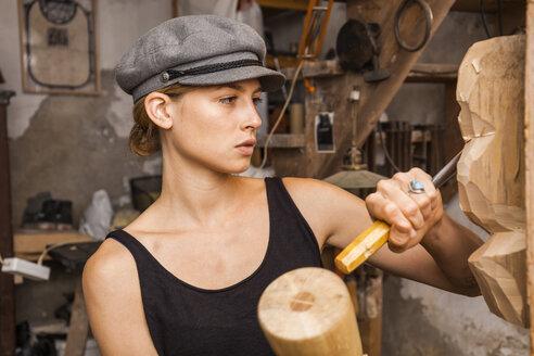 Sculptress carving wooden figure - TCF05717