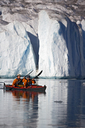 2 man on a double sea kayak in front of a glacier - AURF01954