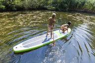 Two girls in a pond on SUP board - TCF05727